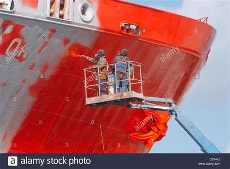 spray paint pirate ship spray painting ship in drydock in spain stock photo
