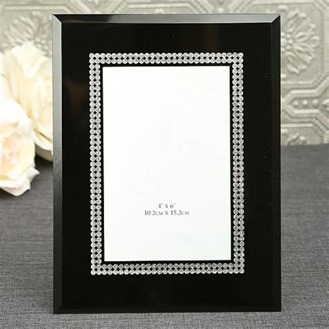 black glass frame with silver wedding favors and