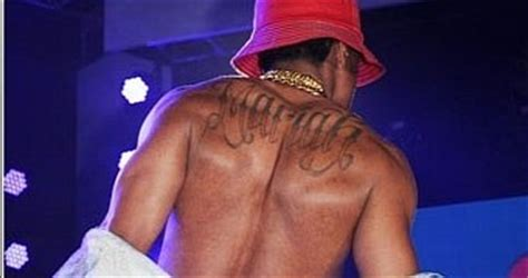 nick cannon tattoo on his back nick cannon turned his into jesus on a cross