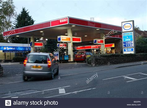 Garage Petrol Station by Esso Petrol Fuel Station Garage Forecourt At Dusk With Car