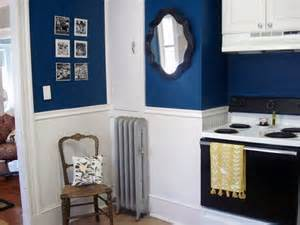Antique mirror in navy blue kitchen we love the color navy blue for