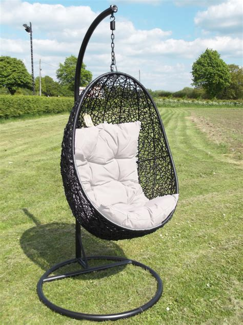swing chair garden oval black wicker hanging swing chair with white cushion