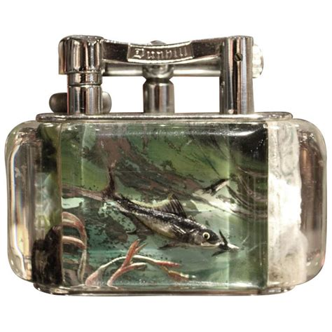 27 Lighters On Dresser by Dunhill Reversed Carved And Painted Aquarium Lighter