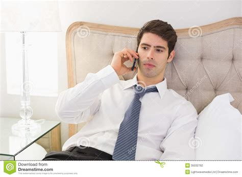 man using cell phone in bed stock images image 33817024 serious well dressed man using mobile phone in bed stock