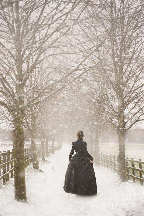 Victorian Shower Bath victorian woman walking a tree lined avenue in snow