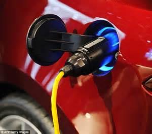 Tesla Electric Car Recharge Tesla S Elon Musk Teases Electric Car That Plugs Itself