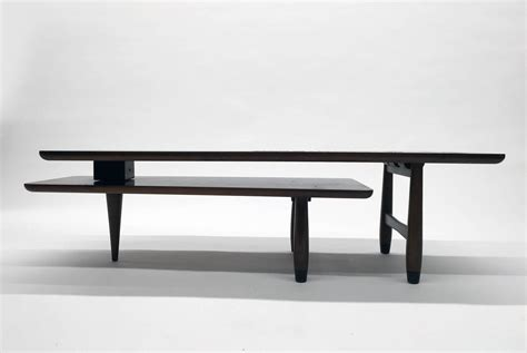 ceramic switchblade quot switchblade quot two tier swivel coffee table with