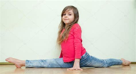 small teen little girl sits on a splits stock photo 169 waldru 27286045