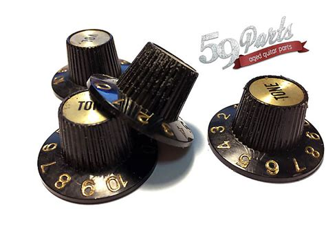 set of 4 aged gibson witch hat knobs black gold es