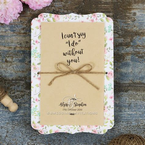 charming blossoms wedding invitation on a rustic canvas