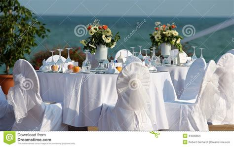Dining Table Set Decoration - outdoor table setting at wedding reception by the sea stock photo image 44500854