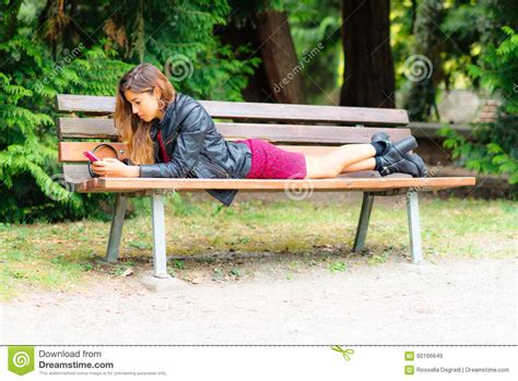 her bench her bench 28 images woman relaxes on garden bench