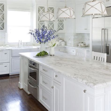 white kitchen cabinets with white marble countertops best 25 carrara marble kitchen ideas on pinterest
