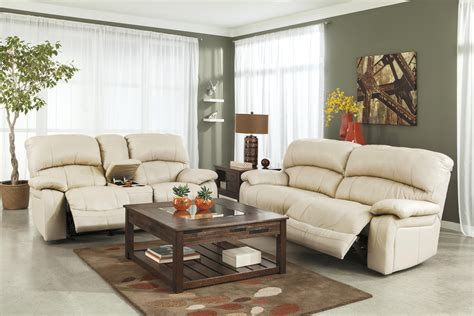 ashley valeton reclining sofa damacio cream u98201 by signature design by ashley