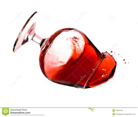 glass spilling red wine spilling from a transparent glass stock