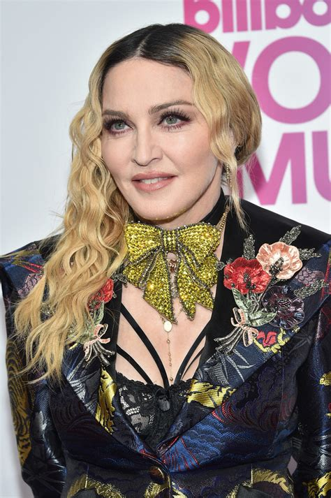 Madonna Hairstyles by Madonna Side Sweep Madonna Hair Looks Stylebistro