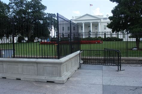 house with fence restoration scoots white house fence a bit farther away scripps howard foundation wire