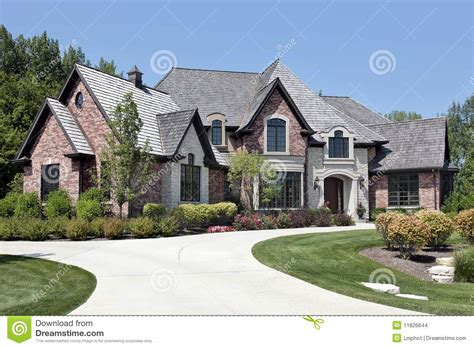European House Designs by Large Brick Home With Circular Driveway Stock Photo