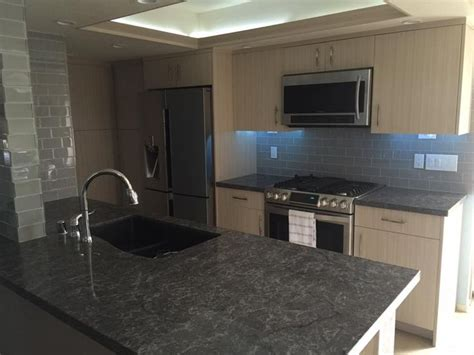 kitchen looks amazing with smoke glass subway tile