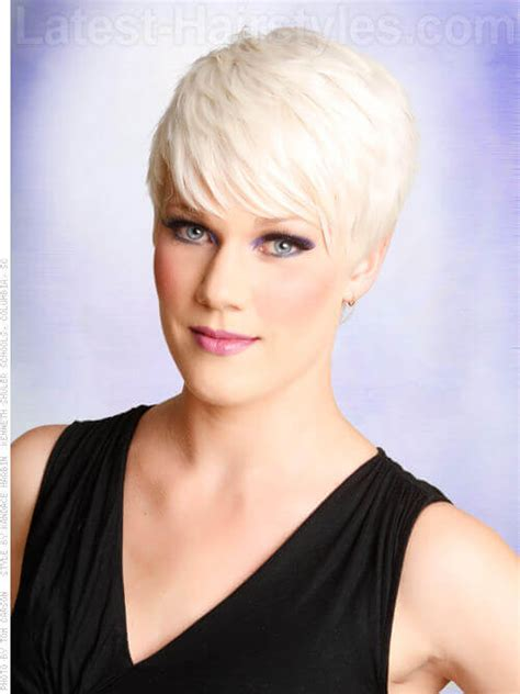 layered top and tapered side haircuts blonde ice platinum pixie cut long bangs