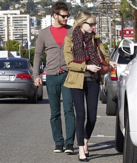 emma stone husband emma stone goes pet shopping wearing art deco scarf
