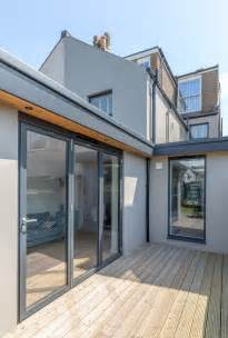 Overhanging Floor L Modern Bi Fold Doors Floor To Ceiling Glazing Flat Roof Extension Painted Grey Render