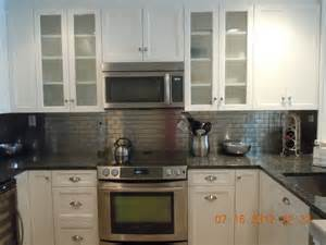 Metal Backsplash For Kitchen by White With Metal Backsplash Traditional Kitchen New