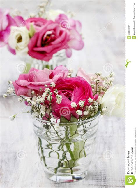 tiny bouquets in glass vases wedding floral decorations