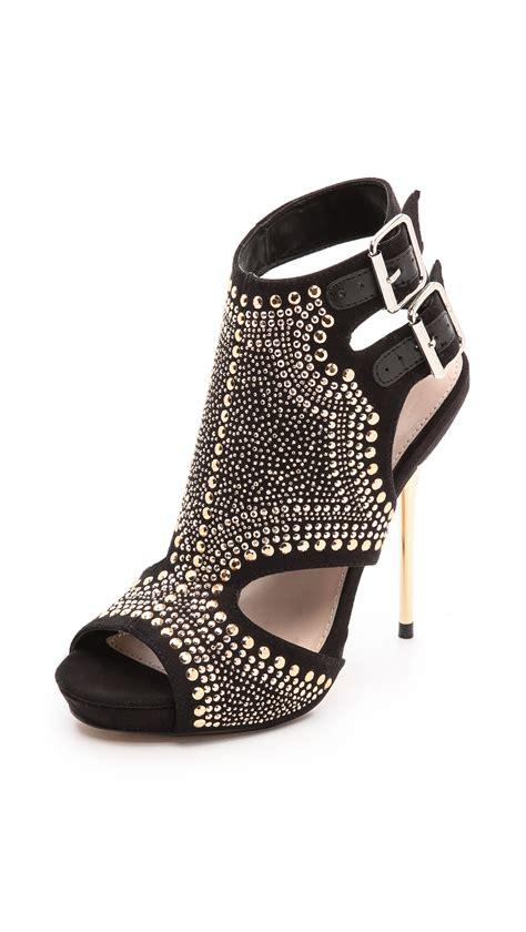 carvela kurt geiger gyrate studded cutout sandals black in black lyst