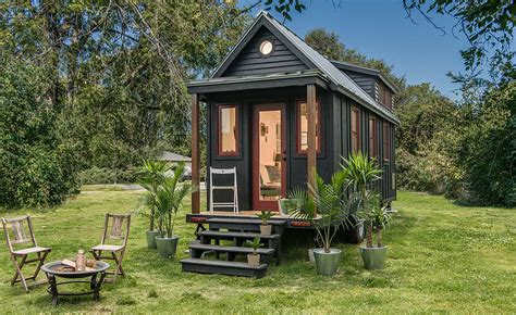 towable riverside tiny house packs every conventional amenity into 246 square feet new frontier