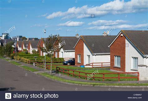 Row House - row of bungalow houses on a suburban estate street uk stock photo royalty free image 51278115