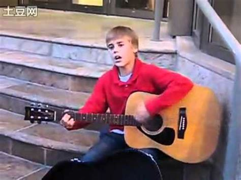 justin bieber biography before he was famous justin bieber s street performance before he got famous