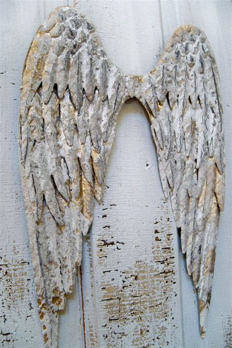 white metal angel wings wall sculpture