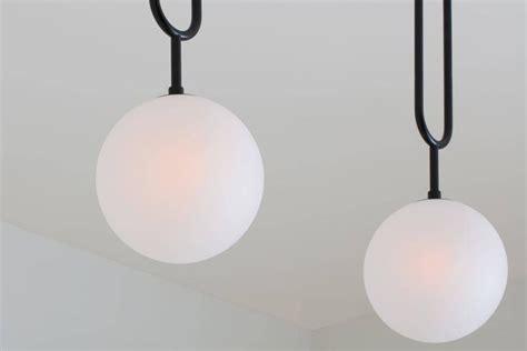 koko modern a koko modern pendant light with satin globe shade and