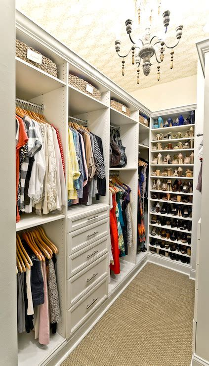 living in a walk in closet closet chandelier transitional closet organized living