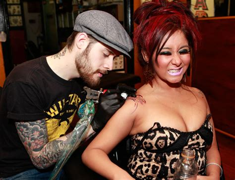 cleavage tattoo snooki new she shows major cleavage