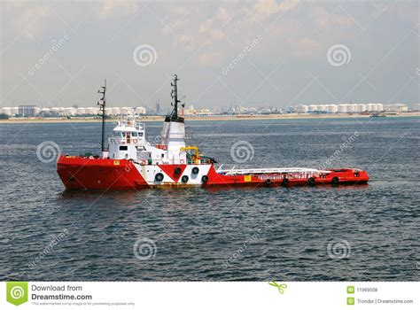 tug boat singapore red and white tug boat in singapore anchorage royalty