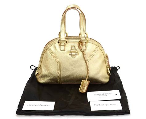 The Yves Laurent Handbags Fall 2008 Collection by Yves Laurent Ysl 2008 Gold Leather Micro Muse Bag At