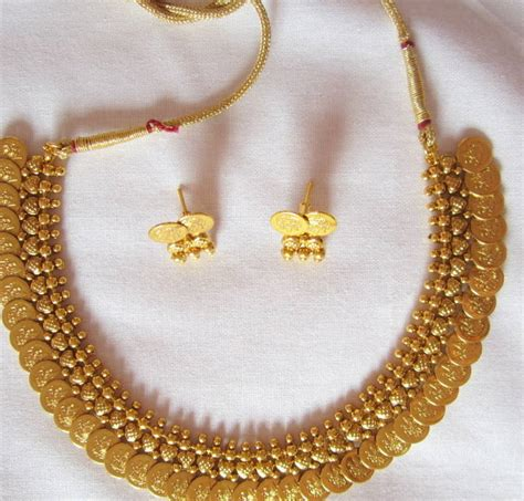 buy crystal jewelry sets onlinelaxmi coin setsearrings buy laxmi haar coin gold plated necklace stud earring