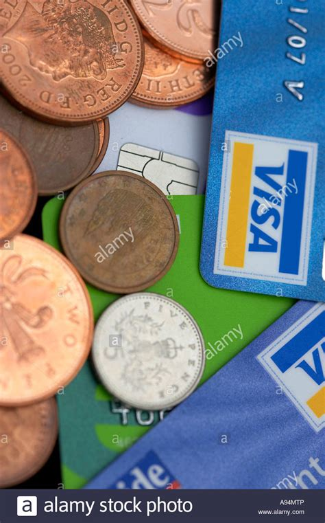Visa Gift Card With Pin - collection of chip and pin visa credit cards with copper and silver stock photo