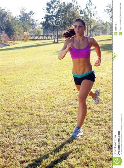 beautiful brunette jogging outdoors  stock images image