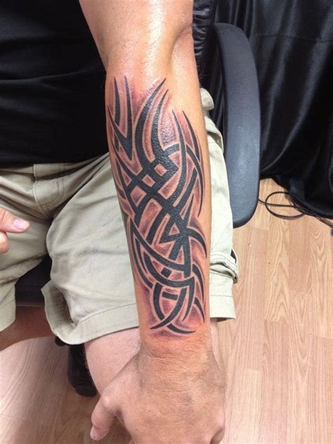 forearm armor tattoos 22 interesting tribal forearm tattoos only tribal