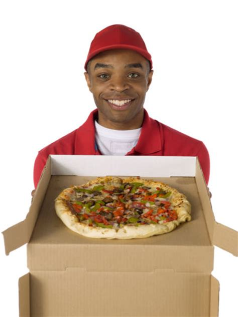 Pizza Delivery Smiling Pizza Delivery Holding Pizza Stock Photo Free