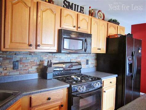 kitchen backsplash with oak cabinets and black appliances kitchen backsplash backsplash sun and slate