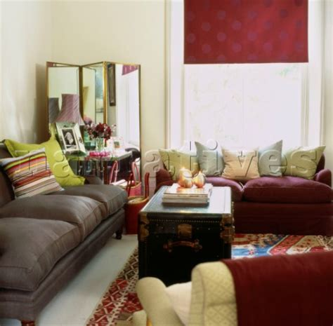 Two Different Sofas In Living Room Jb071 04c Colourful Accessories In Living Room With Tw Narratives Photo Agency