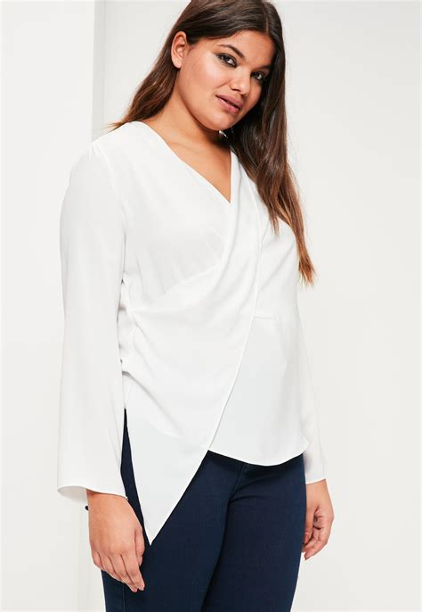 White Tops And Blouses Uk by Missguided Plus Size White Wrap Blouse In White Lyst