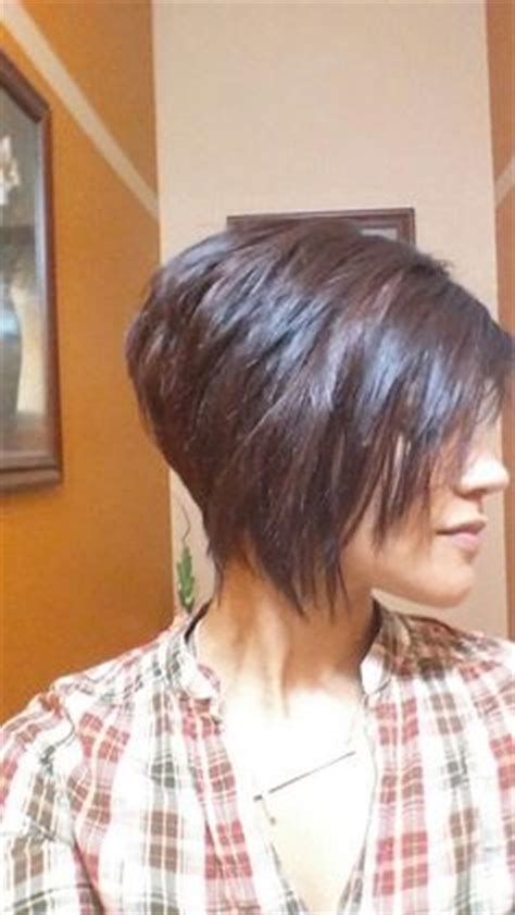is a pixie haircut cut on the diagonal dimensional color highlights lowlights blonde red