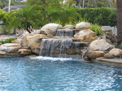 pool waterfalls luxury pools stone walk in pool w beach sand luxury