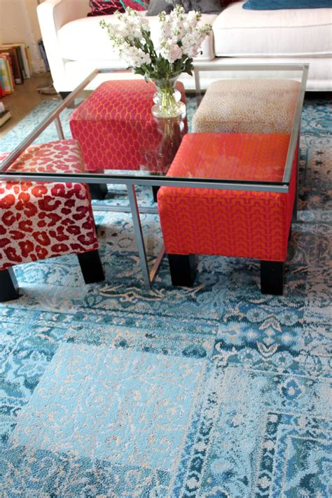 Extra Seating   colorful ottomans under a clear table when not being used