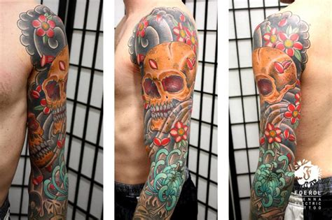flower japanese skull sleeve tattoo by vienna electric tattoo